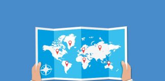 Image of map of the world held by two hands on blue background to show Half of WHO-recommended policies to reduce chronic diseases are not put into practice