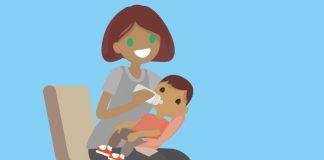 woman feeding a baby to show UK meningitis B vaccination programme begins