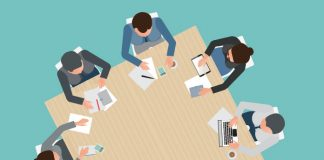 meeting around a table: A guide to implementing Agile in pharma