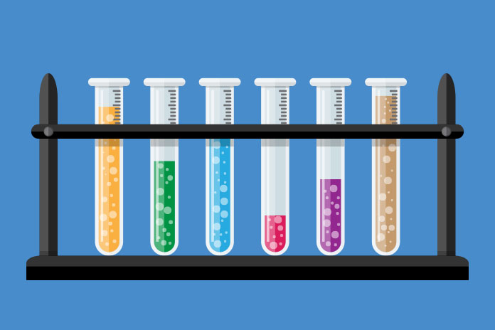 Image of six test tubes containing different coloured liquids to show Clover and GSK collaborate on coronavirus vaccine candidate