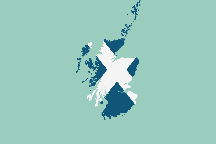 Image of the outline of Scotland with the Scottish flag on the top to show NPA welcomes Scottish pharmacy funding package 2020/21