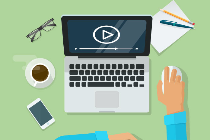 Image of a laptop, phone, glasses, pen, ad, cup of coffee and person with their hand on the mouse to show Pf's new webinar series on Pharma and Integrated Care Systems: How to make your brand relevant