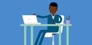 Image of a person sat at a desk with a laptop to indicate Job seeking during COVID-19