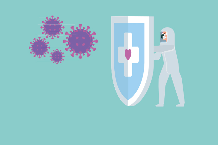 Image of a person in full PPE holding a shield up to a giant coronavirus spore