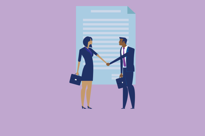 Image of a woman and man shaking hands in front of a contract to show New partnership to drive viral vector vaccine manufacturing including COVID-19
