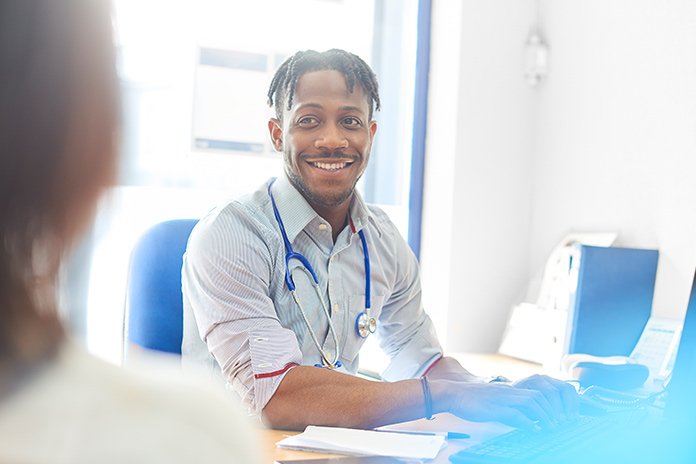Image of a doctor smiling to show New data show the impact of COVID-19 on private healthcare
