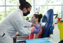 Image of a participant being injected with breast cancer treatment