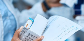 Image of a pharmacist holding tablets to show MHRA response to Independent Medicines and Medical Devices Safety Review