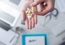 Image f a healthcare professional holding tablets to show Common chronic pain treatments 'can do more harm than good'